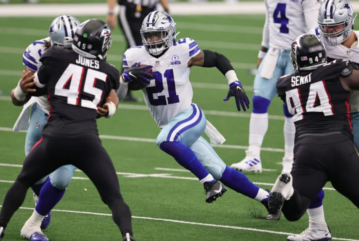 Dallas Cowboys running back Ezekiel Elliott makes a play against Atlanta Falcons on Sunday night.
