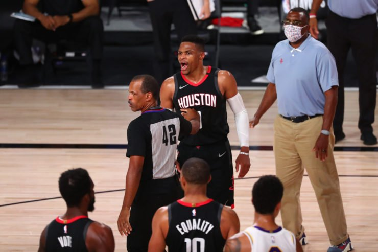 Houston Rockets guard Russell gets into a heated argument with a courtside person at the 2020 NBA Playoffs