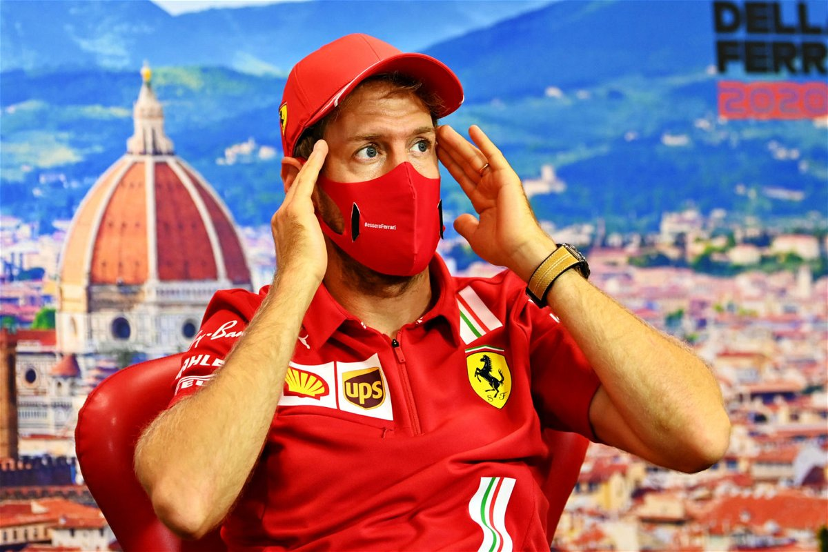 An animated Sebastian Vettel at the drivers' press conference ahead of the Tuscan Grand Prix