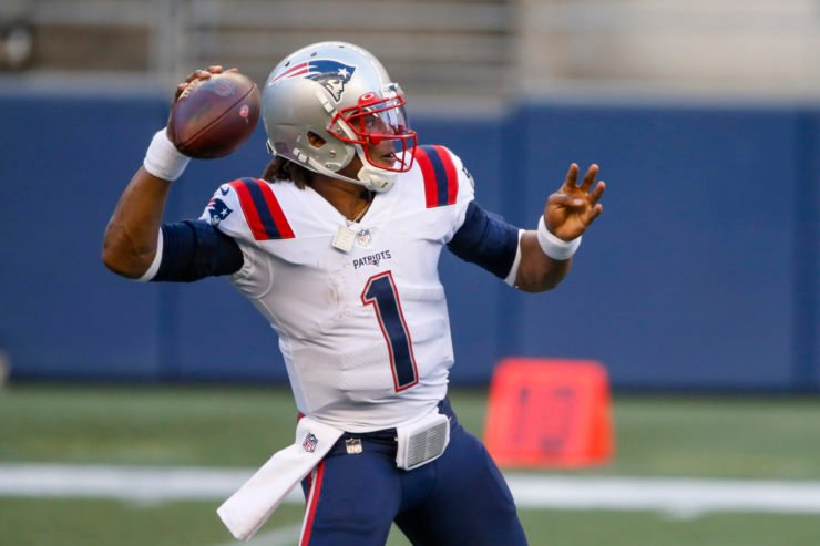 New England Patriots quarterback Cam Newton makes a pass against Seattle Seahawks on Sunday night.