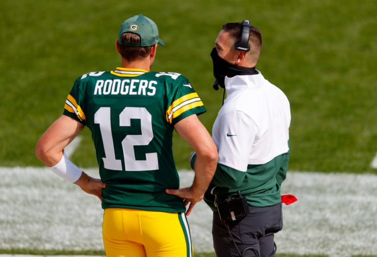 Green Bay Packers quarterback Aaron Rodgers has a chat with head coach Matt LaFleur.