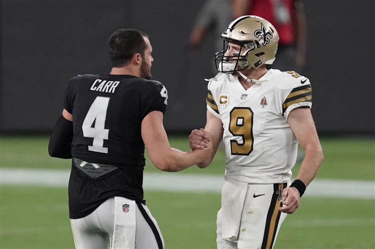 New Orleans Saints quarterback Drew Brees greets Las Vegas Raiders quarterback Derek Carr after Monday night's loss at the Mercedes-Benz Superdome.
