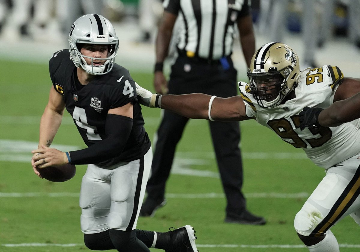 Las Vegas Raiders quarterback Derek Carr attempts to make a play against New Orleans Saints at the Allegiant Stadium on Monday.