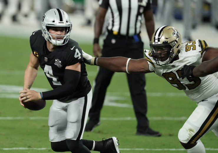 Las Vegas Raiders quarterback Derek Carr attempts to make a play against New Orleans Saints at the Allegiant Stadium on Monday.