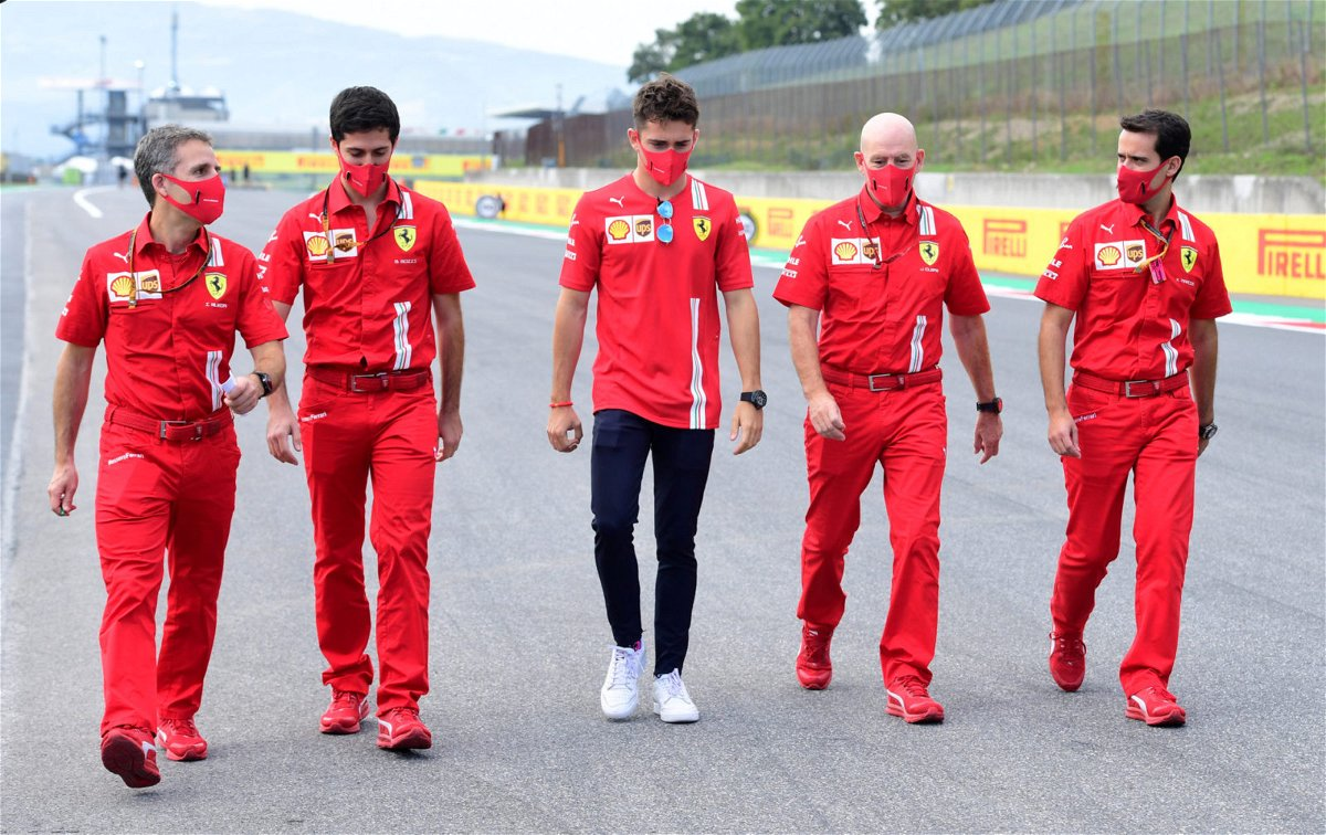 Charles Leclerc in discussions with his team