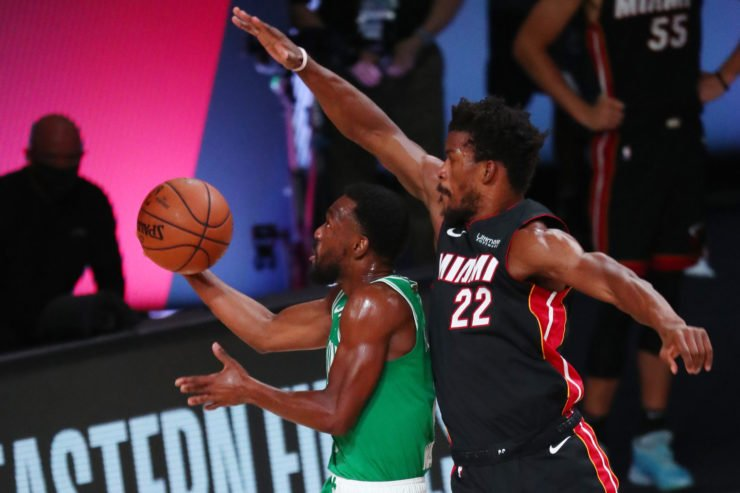 Miami Heat forward Jimmy Butler blocks a shot by Boston Celtics guard