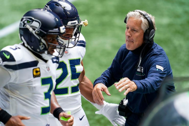 Seattle Seahawks head coach Pete Carroll interacts with his players in the game against Atlanta Falcons in Week One.