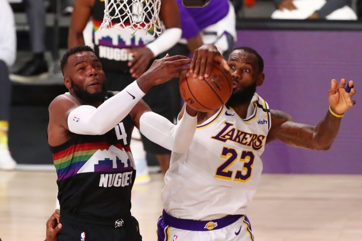 Denver Nuggets forward Paul Millsap and Los Angeles Lakers forward LeBron James
