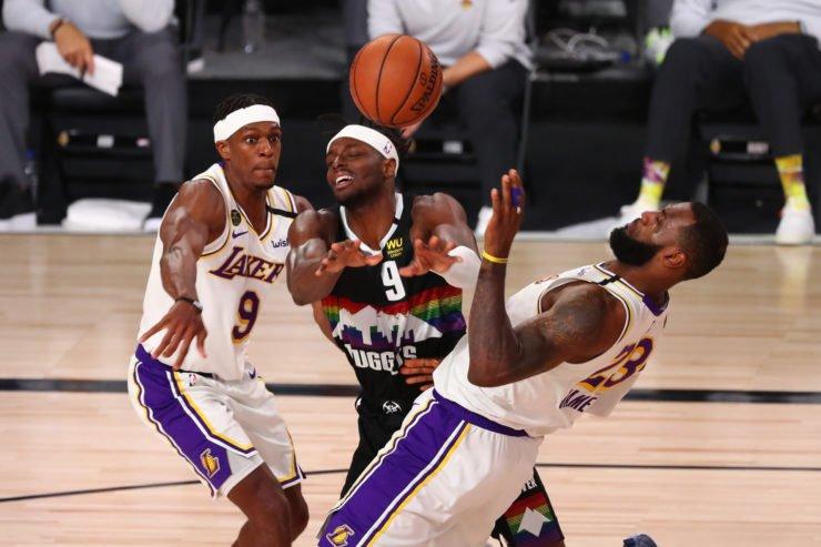 Denver Nuggets forward Jerami Grant battles Los Angeles Lakers guard Rajon Rondo and forward LeBron James
