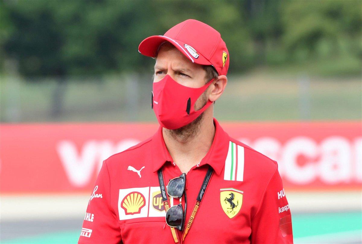 Ferrari driver Sebastian Vettel doesn't look too happy behind the mask