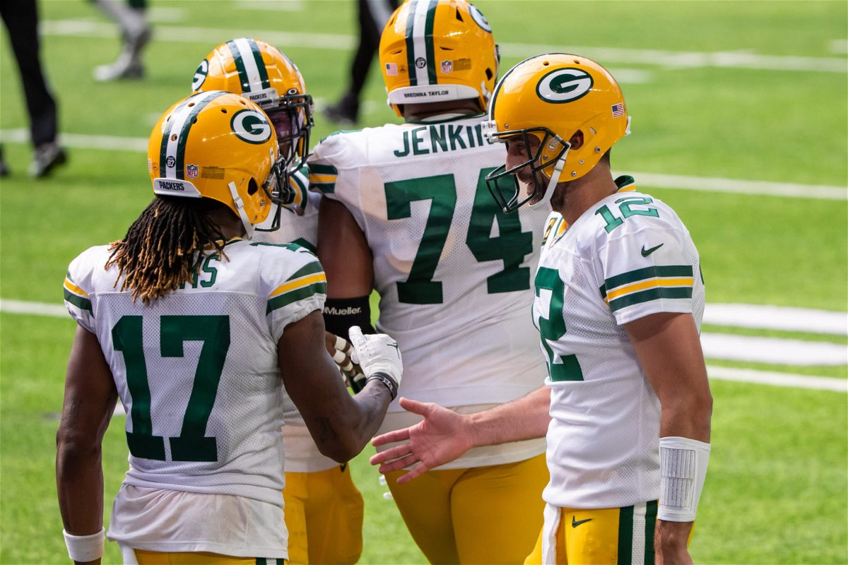 Green Bay Packers quarterback Aaron Rodgers interacts with wide receiver Davante Adams in the game against Minnesota Vikings in Week One.