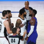 LA Clippers forward Marcus Morris Sr. (middle) and Denver Nuggets forward Paul Millsap in an argument.