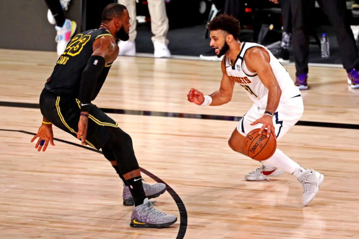 LeBron James defending Jamal Murray during Lakers vs Nuggets Western Conference Finals 2020