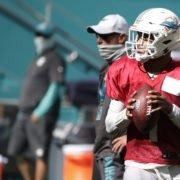 Miami Dolphins quarterback Tua Tagovailoa runs drills during training camp at Hard Rock Stadium.