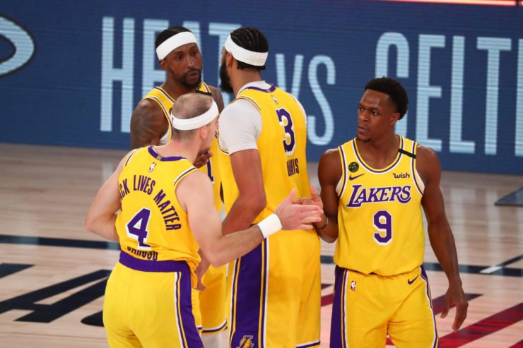 Los Angeles Lakers guard Rajon Rondo celebrates with Anthony Davis, Alex Caruso, and Kentavious Caldwell-Pope