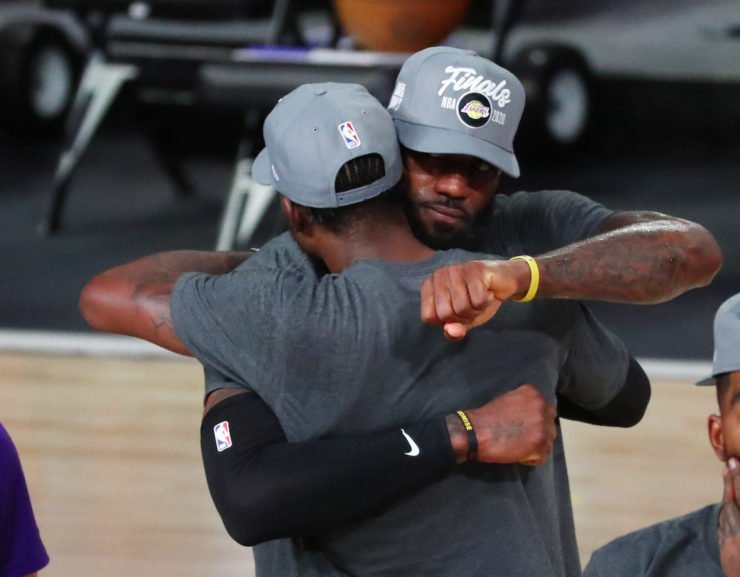 Los Angeles Lakers forward LeBron James celebrates with teammates
