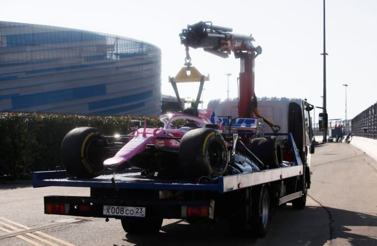 The Racing Point of Lance Stroll being towed away after his crash in Sochi