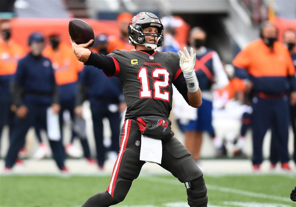 Tampa Bay Buccaneers quarterback Tom Brady attempts a throw against Denver Broncos in Week Three.