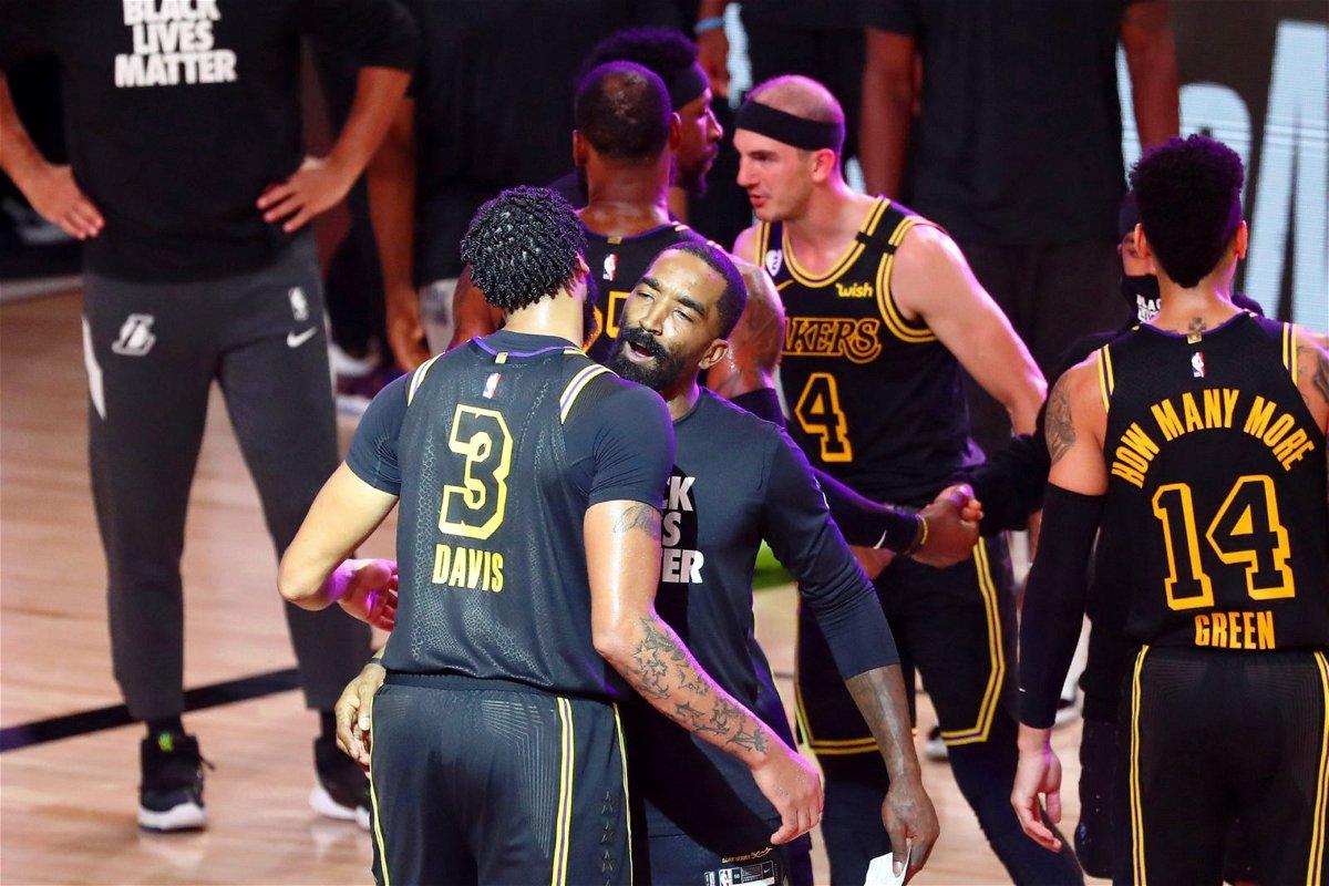 Los Angeles Lakers forward Anthony Davis celebrates with guard JR Smith