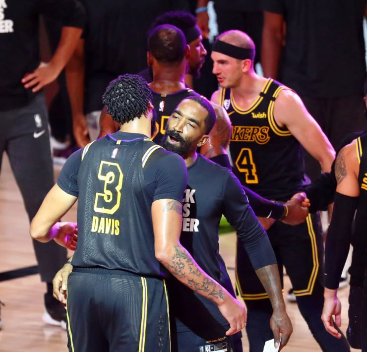 Los Angeles Lakers forward Anthony Davis celebrates with guard JR Smith
