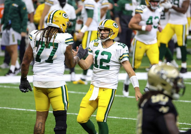 Green Bay Packers quarterback Aaron Rodgers celebrates with teammate Billy Turner against New Orleans Saints in Week Three.