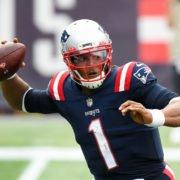New England Patriots quarterback Cam Newton attempts to make a throw against Las Vegas Raiders in Week Three.