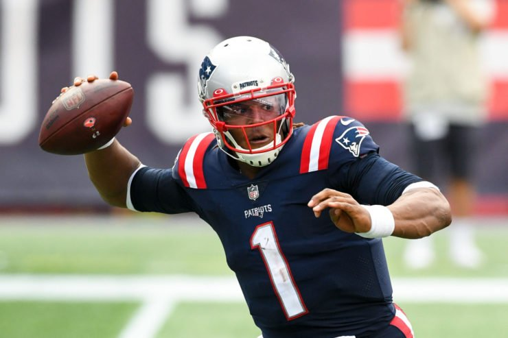 New England Patriots quarterback Cam Newton attempts to make a throw against Las Vegas Raiders in Week Three.