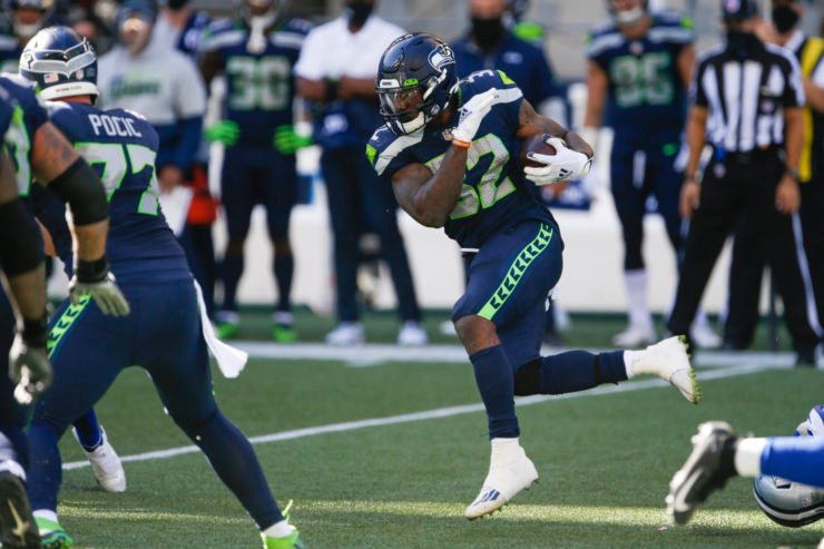 Seattle Seahawks running back Chris Carson attempts to make a play against Dallas Cowboys in Week Three.