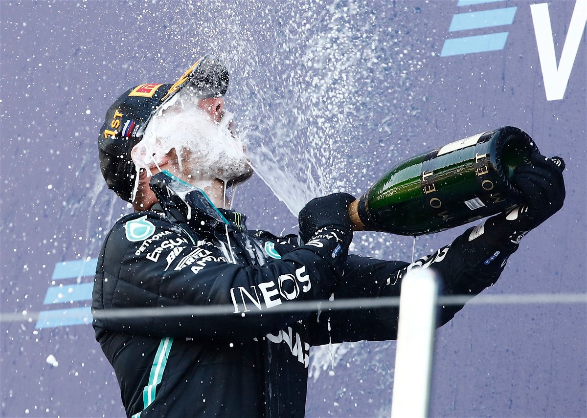 Valtteri Bottas celebrates with a Champagne blast after winning the 2020 Russian Grand Prix for Mercedes F1