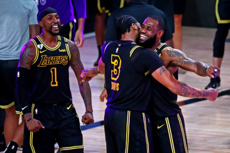 LeBron James celebrates with his duo partner Anthony Davis after Playoff win