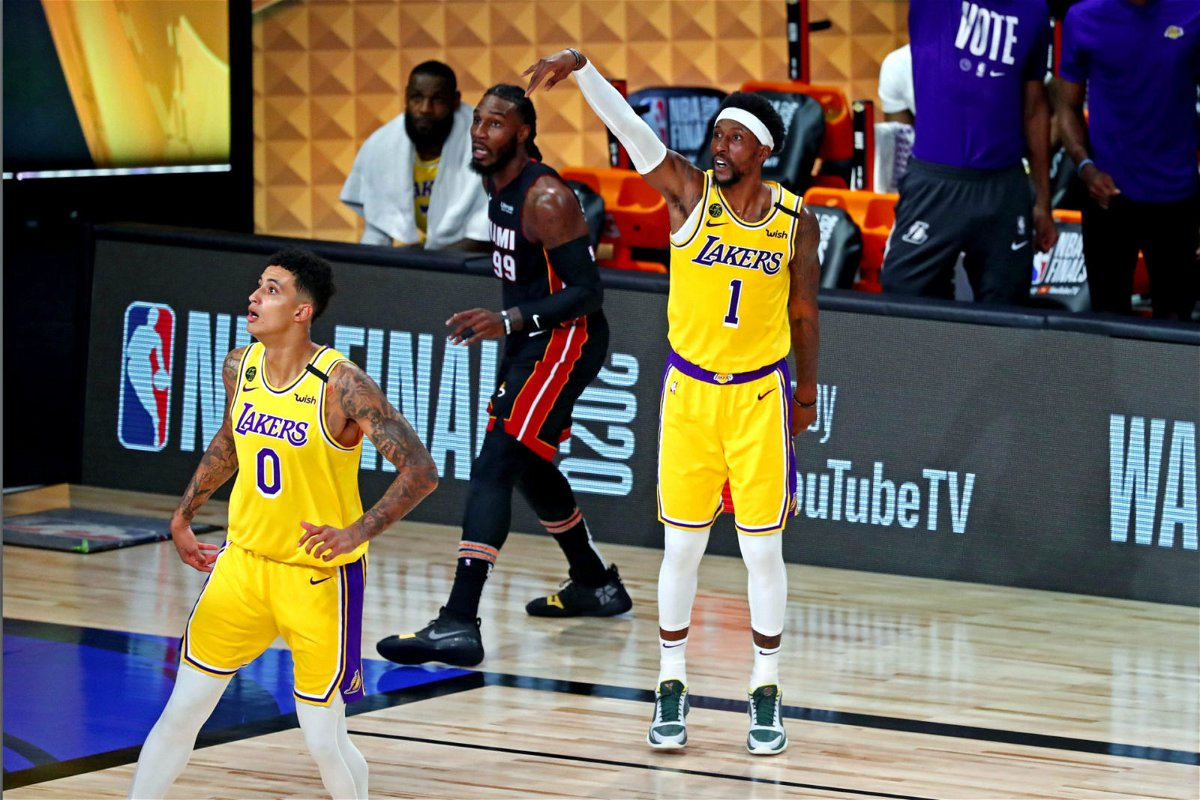 Los Angeles Lakers guard Kentavious Caldwell-Pope reacts to making a three point