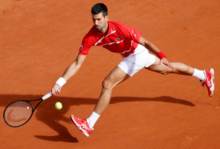 Novak Djokovic plays a forehand at French Open 2020
