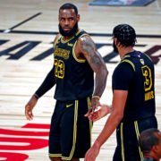 Los Angeles Lakers forward LeBron James celebrates with forward Anthony Davis