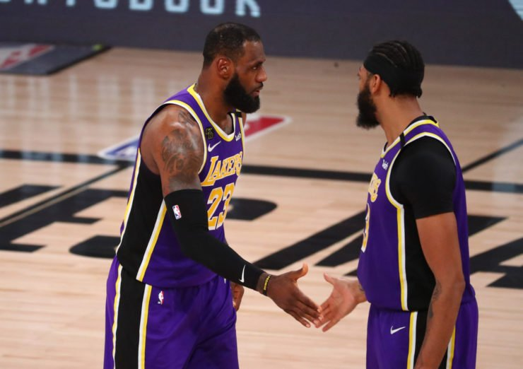 LeBron James shakes hands with forward Anthony Davis