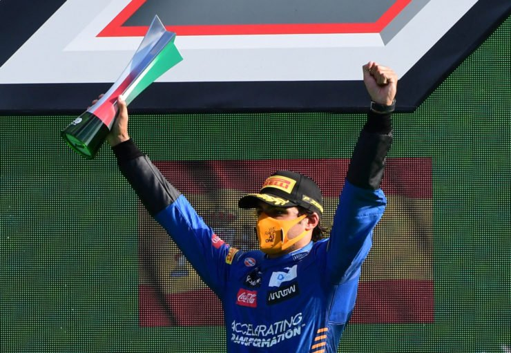 McLaren's Carlos Sainz Jr. celebrates on the podium at Italian grand Prix F1 2020
