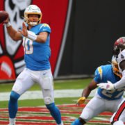 Los Angeles Chargers quarterback Justin Herbert attempts to make a throw against Tampa Bay Buccaneers in Week Four.