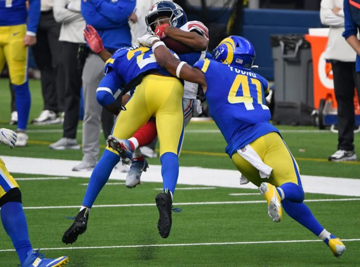 Los Angeles Rams cornerback Jalen Ramsey tackles New York Giants wide receiver Golden Tate in Week Four.