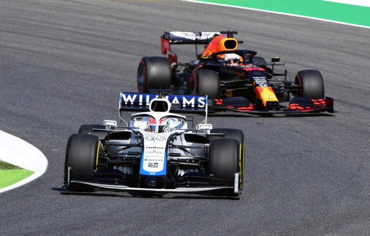 The Williams of George Russell ahead of Max Verstappen during free practice in Tuscany