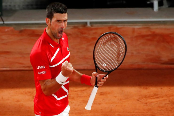 Novak Djokovic celebrates after winning a point at French Open 2020