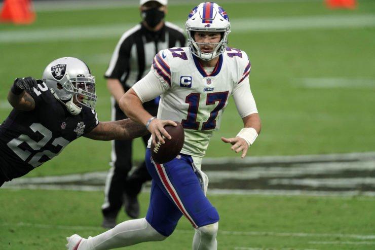 Buffalo Bills quarterback Josh Allen attempts to make play against Las Vegas Raiders in Week Four.