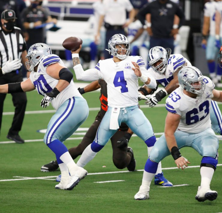 Dallas Cowboys quarterback Dak Prescott attempts to make a throw against Cleveland Browns in Week Four.