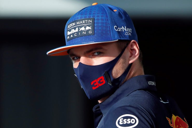 Red Bull driver Max Verstappen looks on in the paddock prior to the Russian Grand Prix