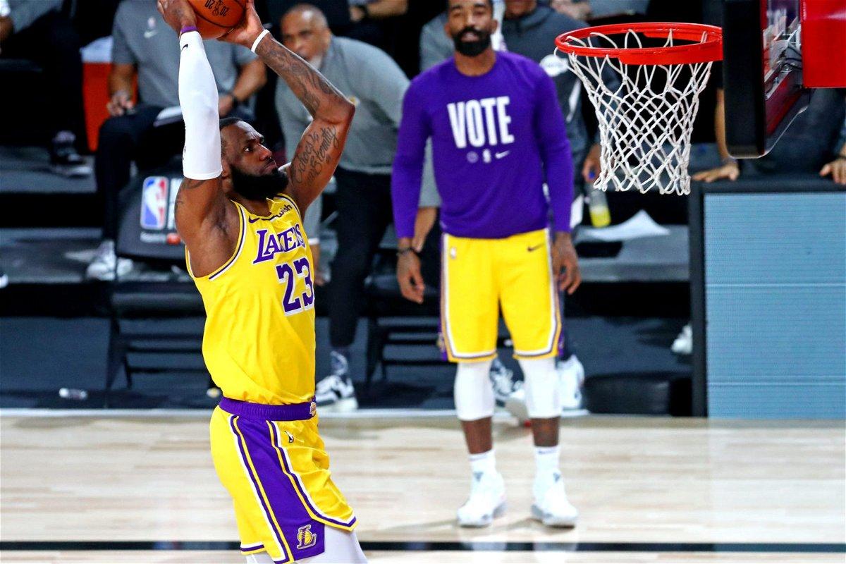 LeBron James attacks the basket against Miami Heat