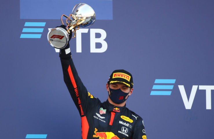 Max Verstappen holds the trophy aloft after finishing P2 at the Russian Grand Prix