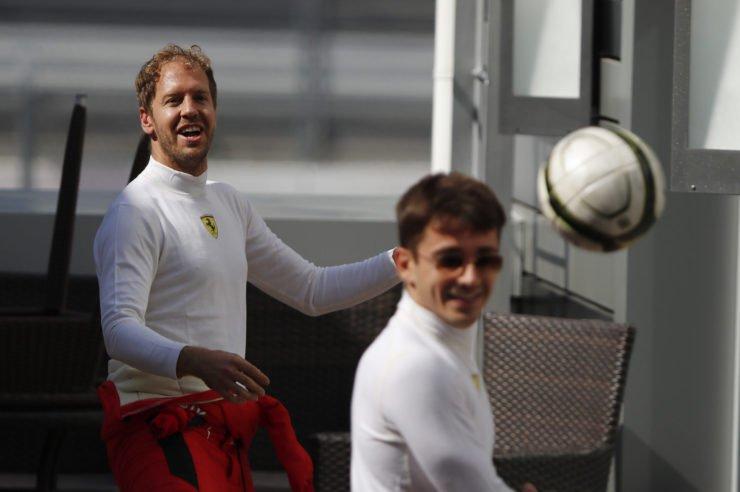 Ferrari's Sebastian Vettel and Ferrari's Charles Leclerc play football ahead of the race at Russian grand Prix