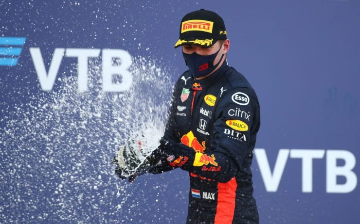Red Bull driver Max Verstappen pops open the champagne after coming home in P2 at the Russian Grand Prix