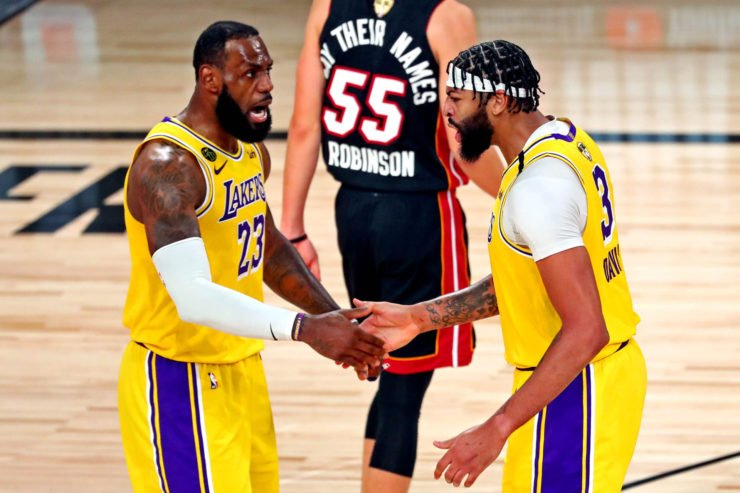 Los Angeles Lakers forward Anthony Davis celebrates with forward LeBron James