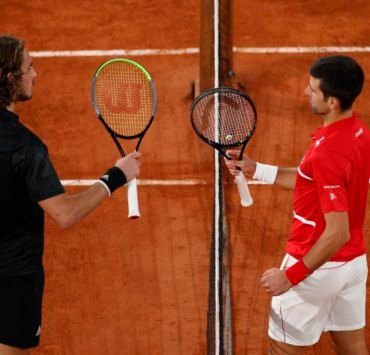 Stefanos Tsitsipas and Novak Djokovic meet at the net after their French Open 2020 semi-final