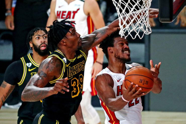 Miami Heat forward Jimmy Butler fouled by Dwight Howard of Lakers