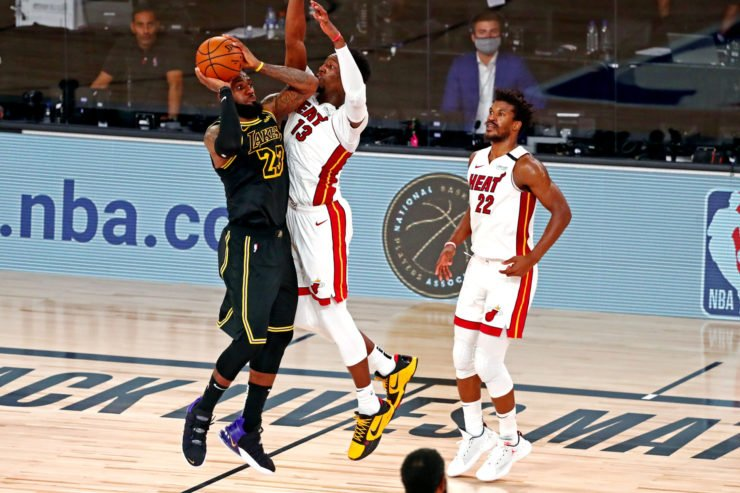 Los Angeles Lakers forward LeBron James against Bam Adebayo and Jimmy Nutler of Miami Heat